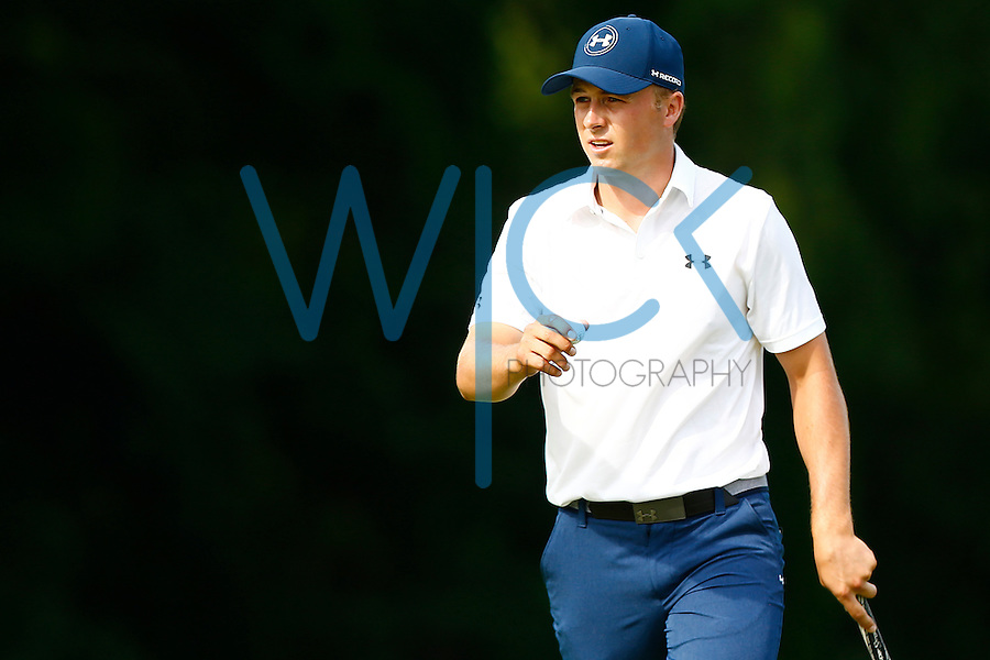 Jordan Spieth reacts following his putt on the 16th green during the 2016 U.S. Open in Oakmont, Pennsylvania on June 18, 2016. (Photo by Jared Wickerham / DKPS)