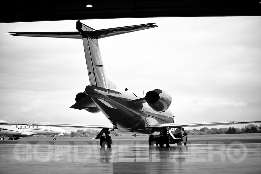 Cessna Citation Learjet being towed from the hanger