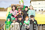 HELPING: St Patrick (Neilus Slattery) with some of the children of Causeway as they get ready to march in the Causeway St Patrick's Day, Parade on Wednesday. Children, Lisa Barrett, Liam Barrett, Micaelle O'Halloran, Shauna Dineen, Fiona Quirke, Ema Kerins, Bri?d Horan, Lisa Kearney and Rebecca Boyd.................................. ....