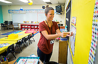 NWA Democrat-Gazette/JASON IVESTER <br /> Candice Edmonson (cq) decorates her calendar on Friday, Aug. 14, 2015, in her classroom at Lowell Elementary School. Edmonson is a new teacher at the school. Students return to class on Monday.