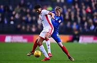 Osman Sow of Mk Dons holds off Chris Forrester go Peterborough during the Sky Bet League 1 match between MK Dons and Peterborough at stadium:mk, Milton Keynes, England on 30 December 2017. Photo by Bradley Collyer / PRiME Media Images.