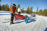 USA, Oregon, Bend, the musher showing a young boy the different parts of the dog sled