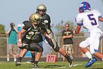 Palos Verdes, CA 09/24/10 - Ryan Sawelson (Peninsula #32) and Brock Dale (Peninsula #7)  in action during the Serra-Peninsula varsity football game at Peninsula High School.