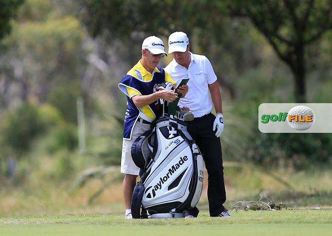 Ronnie Jones &amp; Steve Webster (ENG) deciding on which club to use on the 18th during Round 1 of the ISPS HANDA Perth International at the Lake Karrinyup Country Club on Thursday 23rd October 2014.<br /> Picture:  Thos Caffrey / www.golffile.ie