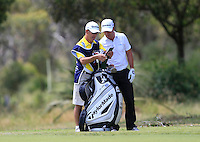 Ronnie Jones & Steve Webster (ENG) deciding on which club to use on the 18th during Round 1 of the ISPS HANDA Perth International at the Lake Karrinyup Country Club on Thursday 23rd October 2014.<br /> Picture:  Thos Caffrey / www.golffile.ie