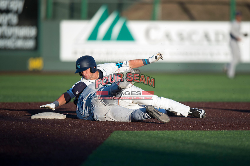 Everett AquaSox Bobby Honeyman (3) is tagged out by Dust Devils second baseman Luke Becker (10) as he slides into second base during a Northwest League game against the Tri-City Dust Devils at Everett Memorial Stadium on September 3, 2018 in Everett, Washington. The Everett AquaSox defeated the Tri-City Dust Devils by a score of 8-3. (Zachary Lucy/Four Seam Images)