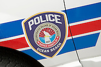 Ocean Beach police logo is pictured on a police car in Ocean Beach on Fire Island in New York state, Wednesday August 3, 2011. The incorporated villages of Ocean Beach and Saltaire within Fire Island National Seashore are car-free during the summer tourist season and permit only pedestrian and bicycle traffic.