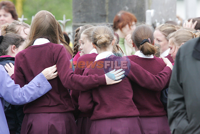 School friends hug together as The funeral of Lisa Callan arrives at Rosaneree church Co Meath..Photo NEWSFILE/FRAN CAFFREY..(Photo credit should read FRAN CAFFREY/NEWSFILE)...This Picture has been sent you under the condtions enclosed by:.Newsfile Ltd..the Studio,.Millmount Abbey,.Drogheda,.Co Meath..Ireland..Tel: +353(0)41-9871240.Fax: +353(0)41-9871260.GSM: +353(0)86-2500958.email: pictures@newsfile.ie.www.newsfile.ie.FTP: 193.120.102.198..This picture is from Fran Caffrey@newsfile.ie