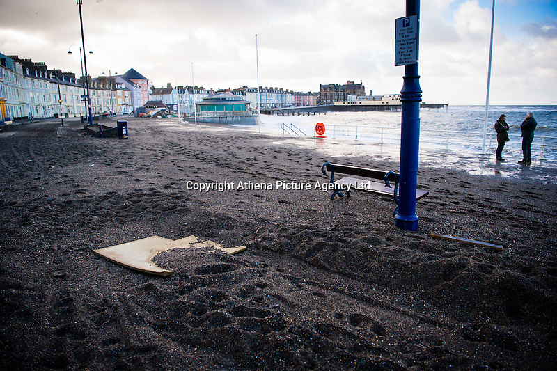 Aberystwyth Wales UK, Tuesday 09 February 2016<br /> UK weather: Sand and debris washed onto the road.<br /> Re: Process of cleaning up the damage caused by Storm Imogen in its aftermath, after it hit Aberystwyth, west Wales
