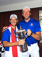 Tommy Fleetwood and his caddy in the team changing room after Team Europe overcame Asia 14/10 to win the Eurasia Cup at Glenmarie Golf and Country Club on the Sunday 14th January 2018.<br /> Picture:  Thos Caffrey / www.golffile.ie