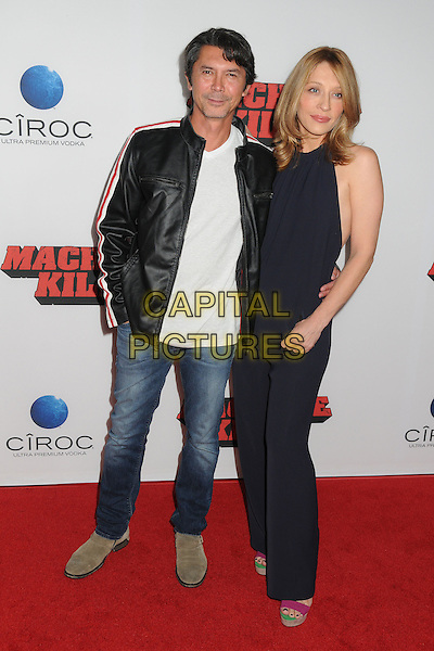 Lou Diamond Phillips, Yvonne Boismier Phillips<br /> The L.A. Premiere of 'Machete Kills' held at The Regal Cinemas L.A. Live in Los Angeles, California, USA.<br /> October 2nd, 2012<br /> full length jumpsuit black white top jeans denim leather jacket married husband wife <br /> CAP/ADM/BP<br /> &copy;Byron Purvis/AdMedia/Capital Pictures