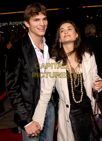 "ASHTON KUTCHER & DEMI MOORE.Columbia Pictures' World Premiere of ""Guess Who"" held at The Grauman's Chinese Theatre in Hollywood, California .March 13th, 2005.half length celebrity couple boyfriend girlfriend gold necklaces jewellery black jacket holding hands .www.capitalpictures.com.sales@capitalpictures.com.Supplied By Capital PIctures"