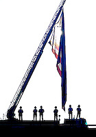Marshall Fire and Rescue personnel stand in silence above an overpass of Rt 66 at the exact time that each plane hit the World Trade Cennter on 9/11.