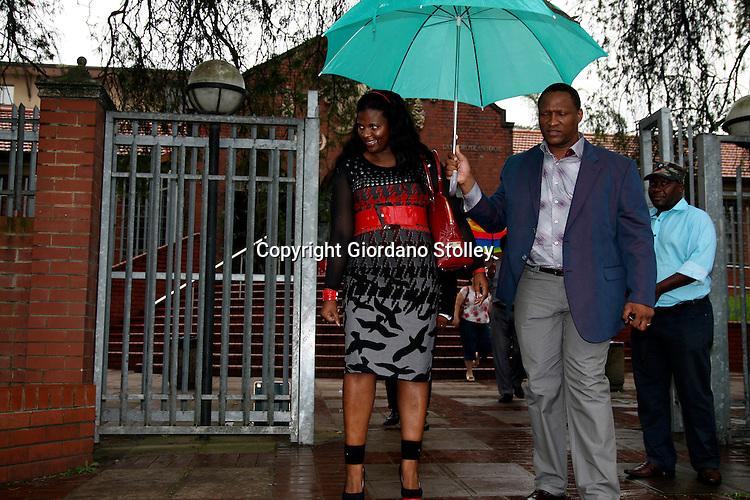 "DURBAN - 15 February 2013 -  Durban business woman Mabongi Flora-Junior ""Shauwn"" Mpisane (Left) leaves the Pinetown Magistrates Court along with husband Sibusiso Mpisane Mpisane. Shauwn is accused of attempting to get a state witness to alter invoices that are evidence in a case involving tax evasion..Stolley/Allied Picture Press/APP.."