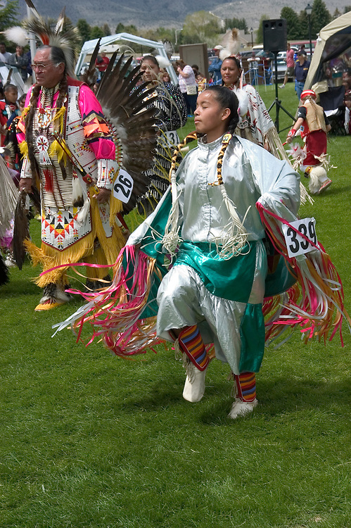 WY: Wyoming, Cody: Dancing at Plains Indian June Powwow...Photo #: yellow571..Photo copyright Lee Foster, 510/549-2202, lee@fostertravel.com, www.fostertravel.com..