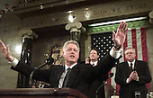 "United States President Bill Clinton holds out his hands as he begins the State of the Union Address during a Joint Session of Congress in Washington, D.C. on January 19, 1999.  In the background are U.S. Vice President Al Gore, left,  and Speaker of the House Dennis Hastert (Republican of Illinois).  Clinton said, ""I stand before you to report that the state of our union is strong.""     .Credit: Win McNamee / Pool via CNP"