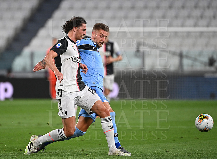 Calcio, Serie A: Juventus - Lazio, Allianz Stadium, July 20, 2020.<br /> Juventus' Adrien Rabiot (l) n action with Lazio's Sergej Milinkovic-Savic (r) during the Italian Serie A football match between Juventus and Lazio at the Allianz stadium in Turin, July 20, 2020.<br /> UPDATE IMAGES PRESS/Isabella Bonotto