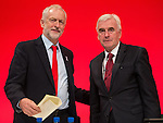 © Joel Goodman - 07973 332324 . 26/09/2016 . Liverpool , UK . Shadow chancellor JOHN MCDONNELL (right) and party leader JEREMY CORBYN after McDonnell delivers his speech on the economy to the conference . The second day of the Labour Party Conference at the ACC Liverpool . Photo credit : Joel Goodman