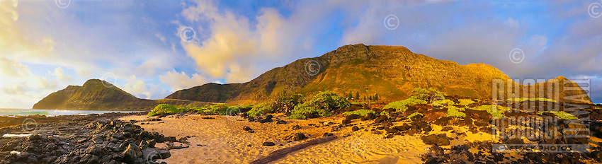 A dramatic sunrise lights up a panorama of the beach and cliffs at Makapu'u, O'ahu.
