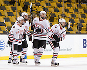 Robbie Vrolyk (NU - 91), David Strathman (NU - 6), Jake Newton (NU - 5), Tyler McNeely (NU - 94) - The Northeastern University Huskies defeated the Harvard University Crimson 4-1 (EN) on Monday, February 8, 2010, at the TD Garden in Boston, Massachusetts, in the 2010 Beanpot consolation game.