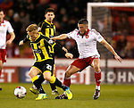 Florent Cuvelier of Sheffield Utd tussles its Mark Duffy of Burton Albion - English League One - Sheffield Utd vs Burton Albion - Bramall Lane Stadium - Sheffield - England - 1st March 2016 - Pic Simon Bellis/Sportimage