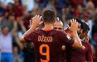 Calcio, Serie A: Roma vs Udinese. Roma, stadio Olimpico, 20 agosto 2016.<br /> Roma&rsquo;s Edin Dzeko, left, celebrates with teammates Radja Nainggolan, center, and Mohamed Salah, after scoring during the Italian Serie A football match between Roma and Udinese at Rome's Olympic Stadium, 20 August 2016. Roma won 4-0.<br /> UPDATE IMAGES PRESS/Riccardo De Luca