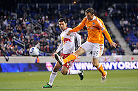 Cam Weaver (15) of the Houston Dynamo shoots and scores as Rafa Marquez (4) of the New York Red Bulls defends. The New York Red Bulls  and the Houston Dynamo played to a 1-1 tie during a Major League Soccer (MLS) match at Red Bull Arena in Harrison, NJ, on April 02, 2011.