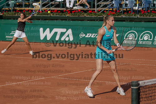 Janette Husarova (L) of Slovakia and Magalena Rybarikova (R) of Slovakia play a winning final against Eva Birnerova (not pictured) of Czech Republic and Michaella Krajicek (not pictured) of Netherlands during the WTA tour Budapest Grand Prix international women tennis competition held in Budapest, Hungary on May 5, 2012. ATTILA VOLGYI