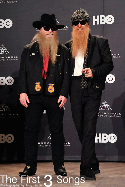 Dusty Hill and Billy Gibbons of ZZ Top in the press room of the Rock & Roll Hall of Fame Induction Ceremony in Cleveland, Ohio on April 14, 2012.