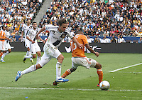 CARSON, CA - DECEMBER 01, 2012:   Todd Dunivant (2) of the Los Angeles Galaxy pushes past Ricardo Clark (13) of the Houston Dynamo during the 2012 MLS Cup at the Home Depot Center, in Carson, California on December 01, 2012. The Galaxy won 3-1.