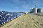 The 200 kW solar array, which will power farm operations, is seen next to the grain handling facilities that include drying and storage, at the Sustainable Agriculture Celebration at Harborview Farms on Thursday, December 6, 2012 in Rock Hall, MD. Harborview Farms is one of the largest and most sustainably driven farming operations in Maryland. (Larry French/AP Images for DuPont)..