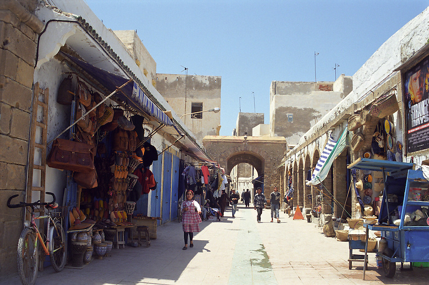 Children walking through a market inside the Medina Walls of Essouira, Morocco
