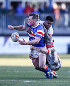 10th February 2019, Belle Vue, Wakefield, England; Betfred Super League rugby, Wakefield Trinity versus St Helens; Matty Ashurst of Wakefield Trinity  passes as he is tackled by Kevin Naiqama and Theo Fages of St Helens