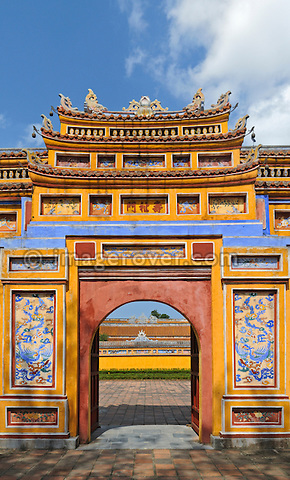 Asia, Vietnam, Hue. Gate to the Queen Mothers Residence. Designated a UNESCO World Heritage Site in 1993, Hue is honoured for its complex of historic monuments. The seat of the Nguyen emperors was in the Citadel, which occupies a large, walled area on the north side of the Perfume river. Inside the citadel was a forbidden city where only the concubines, emperors, and those close enough to them were granted access, the punishment for trespassing being death.