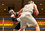 February 3, 2012:   Nevada boxer Josue Gaytan, left, fights against Air Force Academy Logan Brandt in the 192 pound weight class match held at the Eldorado Convention Center on Friday night in Reno, Nevada.  Gaytan won by decision.