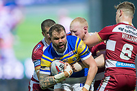 Picture by Allan McKenzie/SWpix.com - 13/04/2018 - Rugby League - Betfred Super League - Leeds Rhinos v Wigan Warriors - Headingley Carnegie Stadium, Leeds, England - Leeds's Adam Cuthbertson is tackled by Wigan's Tony Clubb, Liam Farrell & George Williams.