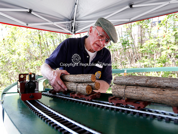 Torrington, CT- 17 May 2015-051715CM05-  Harvey Campbell of Collinsville assembles his model steam train during an open house held by the Torrington Area Model Railroaders, a model train club, at its Torrington building on Sunday.  The open house is being held to mark National Train Day. The Torrington Area Model Railroaders is a group of railroad enthusiasts from across Connecticut who travel throughout the region to watch real trains, and who maintain their model trains inside their building in Torrington's south end.  Christopher Massa Republican-American