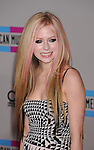 LOS ANGELES, CA. - November 21: Avril Lavigne arrives at the 2010 American Music Awards held at Nokia Theatre L.A. Live on November 21, 2010 in Los Angeles, California.