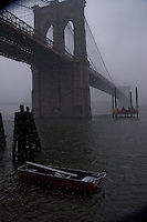 Snowing on boat in the East river,Brooklyn bridge. Images of New York 2004, New York,U.S.A