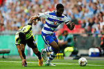 Tyler Blackett of Reading takes on Elias Kachunga of Huddersfield Town during the SkyBet Championship Play Off Final match at the Wembley Stadium, England. Picture date: May 29th, 2017.Picture credit should read: Matt McNulty/Sportimage