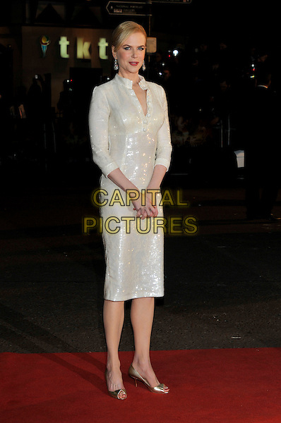 "NICOLE KIDMAN.""Australia"" UK film premiere, Odeon cinema, Leicester Square, London.10th December 2008.full length white sequined sequins cream dress long sleeves open toe gold shoes christian louboutin buttons tunic.CAP/PL.©Phil Loftus/Capital Pictures"
