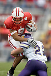 MADISON, WI - SEPTEMBER 9: Linebacker Aaron Miller #22 of the Western Illinois Leathernecks tackles tight end Travis Beckum #9 of the at Camp Randall Stadium on September 9, 2006 in Madison, Wisconsin. The Badgers beat the Leathernecks 34-10. (Photo by David Stluka)