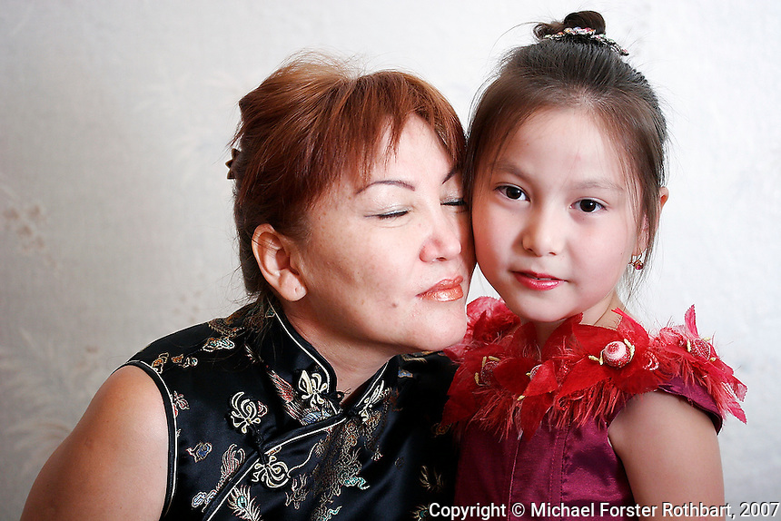 Nazigul Suttibaeva embraces her daughter Gulsum, age 7. Nazigul works for the NGO Iris, in Semey, Kazakhstan, founded to help people affected by 40 years of nuclear testing in the Semipalatinsk Polygon. &quot;I have seen many terrible effects of radiation,&quot; says Nazigul. &quot;I thank god my daughter is still healthy.&quot; <br />  <br /> &copy; Michael Forster Rothbart<br /> www.mfrphoto.com <br /> 607-267-4893 o 607-432-5984<br /> 5 Draper St, Oneonta, NY 13820<br /> 86 Three Mile Pond Rd, Vassalboro, ME 04989<br /> info@mfrphoto.com<br /> Photo by: Michael Forster Rothbart<br /> Date: 8/2007    File#:  Canon 20D digital camera frame 12731