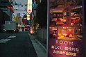 "July 5, 2011 - Tokyo, Japan - A sign of a love hotel says ""There are 30 enjoyable and unique rooms to choose from."" In the Kabukicho district of Shinjuku, love hotels are used for short stays which are commonly used by couples to conduct intimate activities. Love hotels are popular especially among young Japanese couples that still live with their parents and want to have a place to spend a private moment together with their partner. Many of these hotels are also known to be used for prostitution activities."