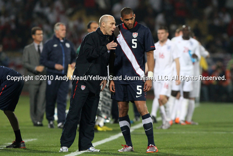 12 JUN 2010: United States head coach Bob Bradley (left) talks with Oguchi Onyewu (USA) (5) during a stoppage. The England National Team played the United States National Team to a 1-1 tie at Royal Bafokeng Stadium in Rustenburg, South Africa in a 2010 FIFA World Cup Group C match.