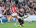 Stoke's Darren Fletcher tussles with Manchester United's Ander Herrera during the premier league match at the Britannia Stadium, Stoke on Trent. Picture date 9th September 2017. Picture credit should read: David Klein/Sportimage