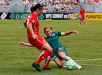 St. Louis Athletica midfielder Lori Chalupny (17) knocks the ball away from Washington Freedom defender/midfielder Ali Krieger (27) during a WPS match at Anheuser-Busch Soccer Park, in Fenton, MO, June 20 2009. Washington  won the match 1-0.