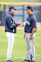 Buddy Black - manager. San Diego Padres and Don Wakamatsu - manager, Seattle Mariners talk on the field during the annual Spring Training Fanfest at Peoria Sports Complex in Peoria, AZ - 02/27/2010.Photo by:  Bill Mitchell/Four Seam Images.