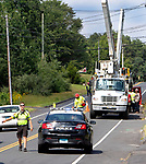 WOLCOTT CT. - 08 August 2020-080820SV06-Electrical crews working with Eversource hang power lines on Wolcott Road in Wolcott Saturday.<br /> Steven Valenti Republican-American