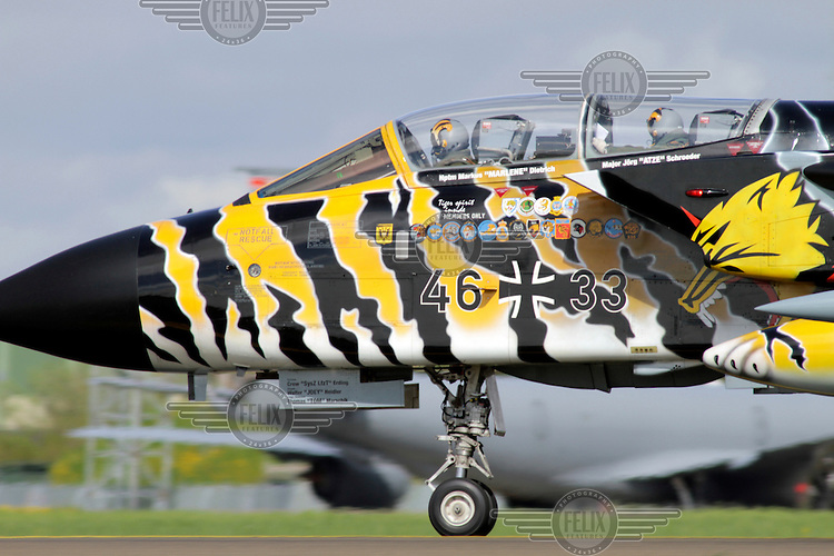 A German Tornado fighter jet in tiger stripes. Nato Tiger Meet is an annual gathering of squadrons using the tiger as their mascot. While originally mostly a social event it is now a full military exercise. Tiger Meet 2012 was held at the Norwegian air base Ørlandet.
